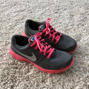 Nike pink and gray athletic shoes size 9.5